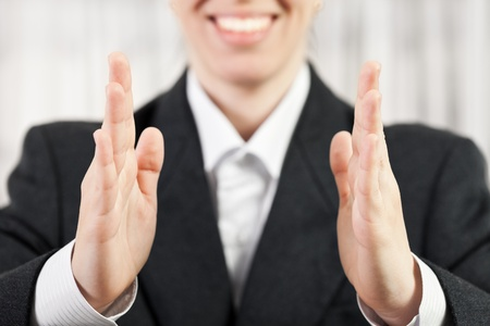Beauty smiling business woman hand showing middle size photo