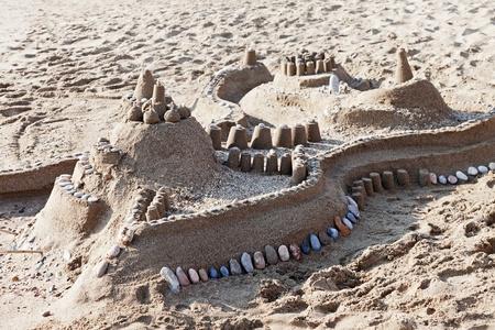 Sandcastle - summer vacations castle on sea sand beach photo