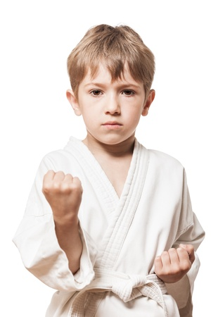 martial art: Martial art sport - child boy in white kimono training karate punch