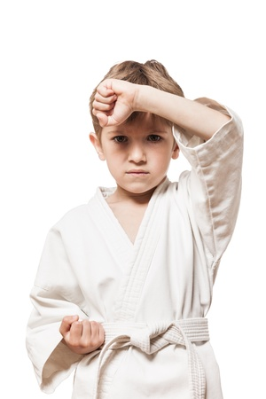 tae: Martial art sport - child boy in white kimono training karate punch
