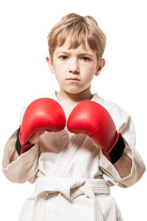 boy boxing: Martial art sport - child boy in white kimono training karate punch