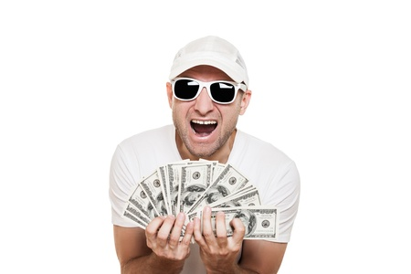 Cool smiling man in sunglasses with full hands holding dollar currency cash photo