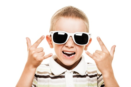 Beauty smiling child boy in sunglasses gesturing white isolated photo