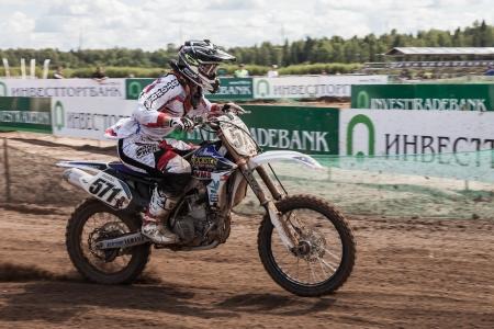SEMIGORJE, RUSSIA - JULY 22: Grand Prix of Russia of FIM Motocross World Championship MX1 and MX2 Series on July 22, 2012 in Semigorje, Russia Stock Photo - 14542352