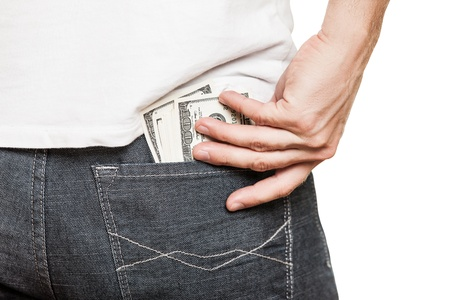 hands in pockets: Human hand holding dollar currency cash taking banknote out of jeans pocket