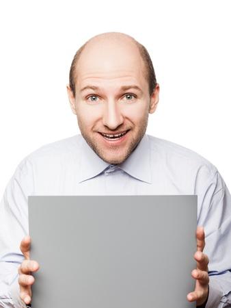 Bald smiling man hand holding grey empty blank card Stock Photo - 14795750