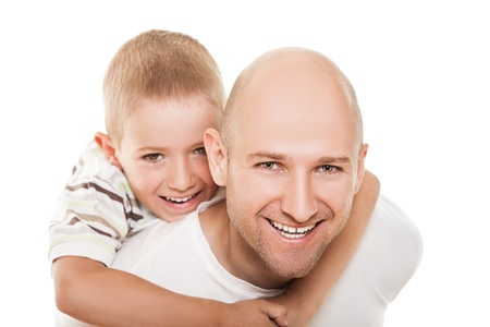 shaved head: Smiling father and little son - family happiness