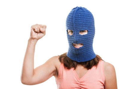 Russian protest movement concept - woman wearing balaclava or mask on head showing raised fist hand gesture white isolated Stock Photo - 15211860