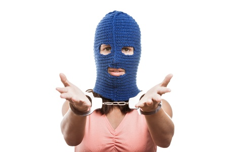Russian protest movement concept - woman wearing balaclava or mask on head showing handcuffs on hands white isolated Stock Photo - 15211822