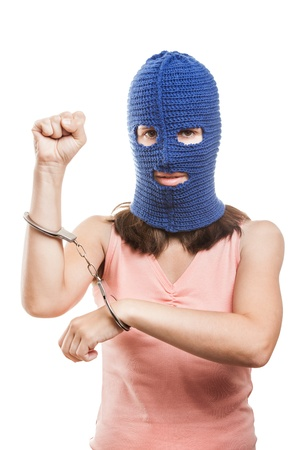 Russian protest movement concept - woman wearing balaclava or mask on head showing handcuffs on hands white isolated photo