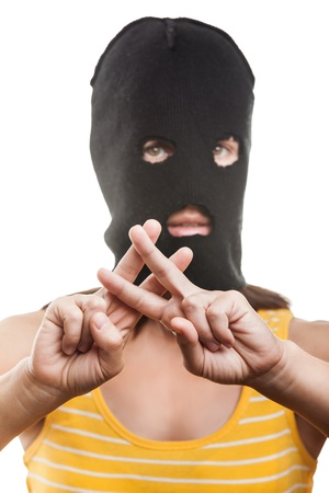 Russian protest movement concept - woman wearing balaclava or mask on head showing jail or prison finger gesture white isolated Stock Photo - 15211820