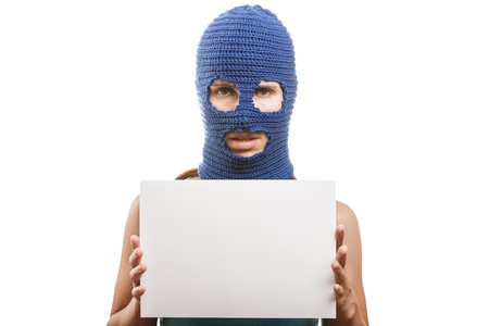 Russian protest movement concept - woman wearing balaclava or mask on head holding blank white card in hands white isolated Stock Photo - 15211816