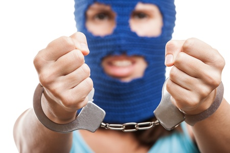 Russian protest movement concept - woman wearing balaclava or mask on head showing handcuffs on hands white isolated Stock Photo - 15211863