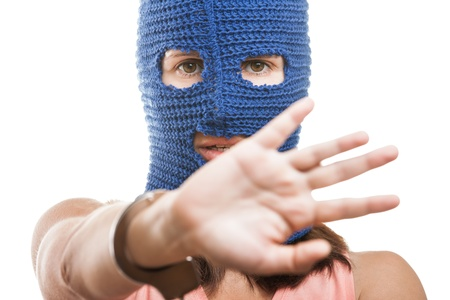 Russian protest movement concept - woman wearing balaclava or mask on head gesture shielding or showing stop sign white isolated Stock Photo - 14965990