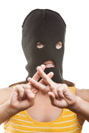 Russian protest movement concept - woman wearing balaclava or mask on head showing jail or prison finger gesture white isolated Stock Photo - 14965989