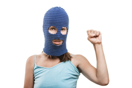 Russian protest movement concept - woman wearing balaclava or mask on head showing raised fist hand gesture white isolated Stock Photo - 14965977