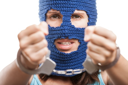 Russian protest movement concept - woman wearing balaclava or mask on head showing handcuffs on hands white isolated Stock Photo - 14965997