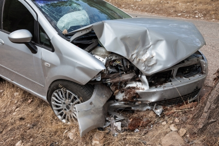 Road accident crash damaged car or wreck broken vehicle Standard-Bild