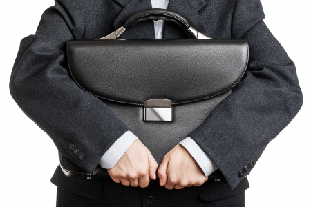 suit case: Business man in black suit hand holding briefcase Stock Photo