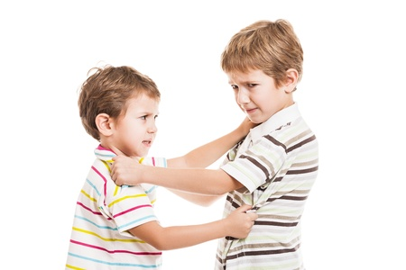 people arguing: Two little displeased child boy brothers fighting in family conflict