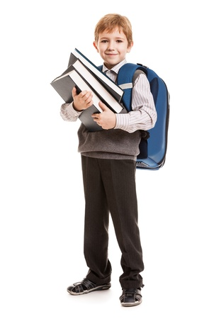 satchel: Little smiling child boy with school backpack holding education books in hands