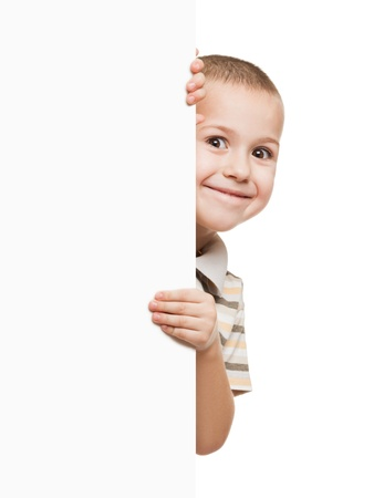 Little smiling child boy holding blank white sign or placard