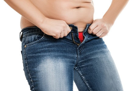 Overweight woman wearing jeans on fat body belly paunch photo