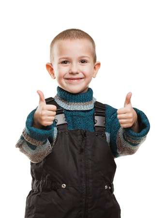 Little smiling child boy hands gesturing thumb up success sign photo