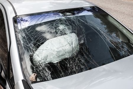 Road accident crash damaged car or wreck broken vehicle with used airbag