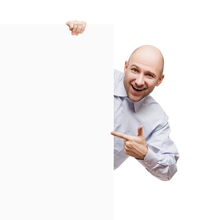 Handsome smiling bald or shaved head man holding blank sign or placard white isolated