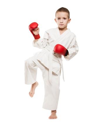 jujitsu: Martial art sport - child boy in white kimono training karate punch or kick
