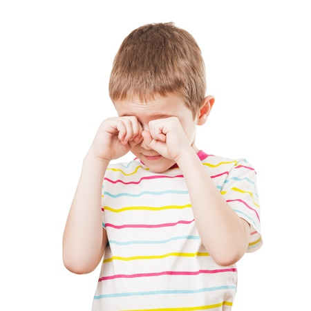 anger kid: Little crying child hands hiding or covering face white isolated Stock Photo