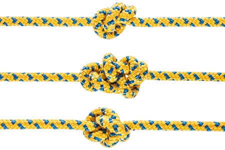 texture twisted: Twisted rope or string with tied knot white isolated