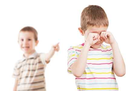 Two little displeased child boy brothers in family conflict quarrel Stock Photo