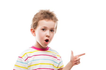 kid pointing: Little amazed or surprised child boy hand gesturing or index finger pointing