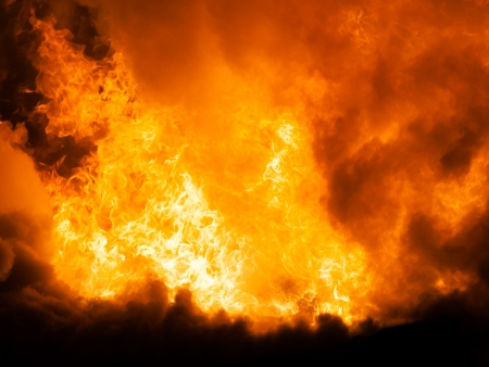 Arson or nature disaster - burning fire flame on wooden house roof Stock Photo - 20353565