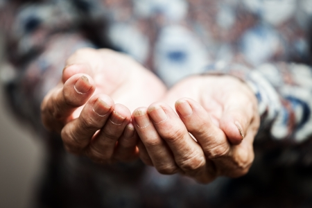 Beggar people and human povetry concept - senior person hands begging for food or help