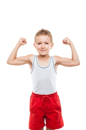 Beauty smiling sport child boy showing his hand biceps muscles strength white isolated Stock Photo