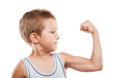 Beauty smiling sport child boy showing his hand biceps muscles strength white isolated Stockfoto