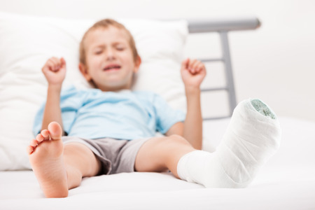 plaster foot: Human healthcare and medicine concept - little child boy with plaster bandage on leg heel fracture or broken foot bone