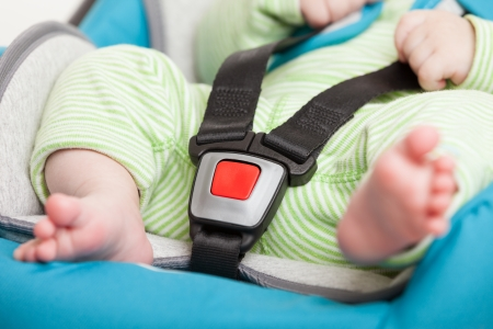 car seat: Little baby child fastened with security belt in safety car seat
