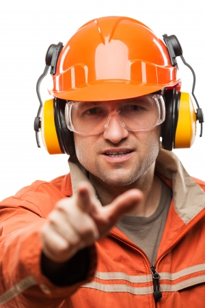 Construction building engineer or manual worker man in safety hardhat helmet finger pointing white isolated photo