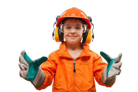 Little smiling child boy engineer or manual worker in safety hardhat helmet and gloves white isolated photo