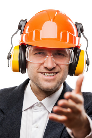 Businessman in black suit and safety hardhat helmet gesturing hand greeting or meeting handshake white isolated photo
