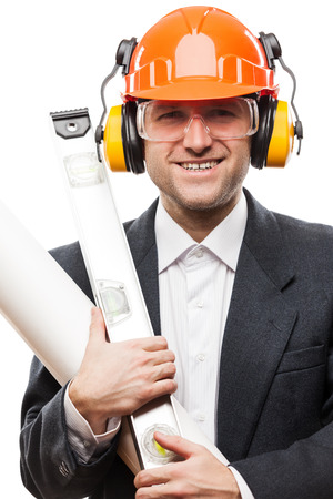 Businessman in black suit and safety hardhat helmet hand holding paper drawings plan and engineer tools white isolated photo