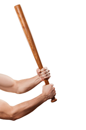 Violence and aggression concept - furious angry man muscular hand holding baseball sport bat photo