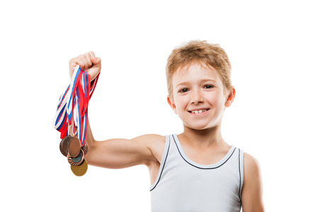 Sport success and win concept - smiling athlete champion child boy hand holding first place victory gold medal award Stockfoto