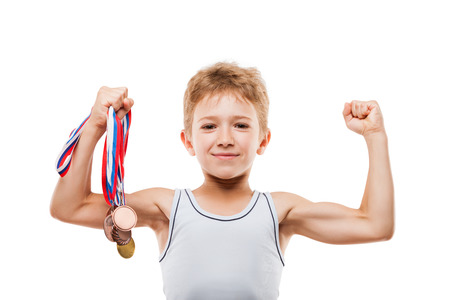 Sport success and win concept - smiling athlete champion child boy hand holding first place victory gold medal award Фото со стока
