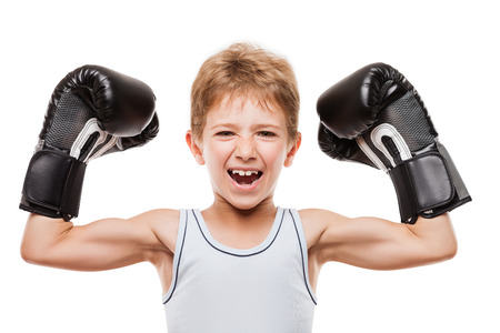 boy muscles: Martial art sport success and win concept - smiling boxing champion child boy gesturing for first place victory triumph