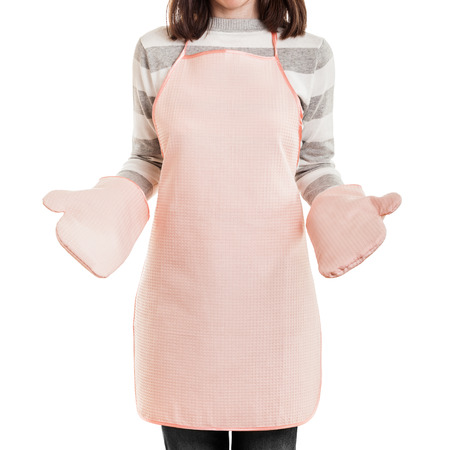 Kitchen working housewife concept - beauty woman wearing food cooking apron and oven mitt white isolated Stockfoto